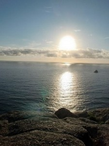 Puesta de sol en cabo Finisterre, vistas casa rural con SPA